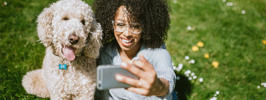 Woman taking a selfie with a dog